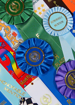 assorted rosette and award ribbons