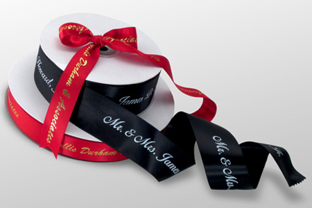 Two ribbon rolls of double faced satin with continuous printing.