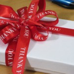 red thank you ribbon for administrative professionals day and other holidays