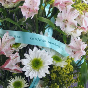 use custom ribbons for decorating with flowers at a wedding