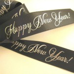custom ribbon rolls and wishing a happy new year