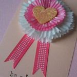 ribbon rolls and cupcake liners used to make rosette ribbons for valentine's day