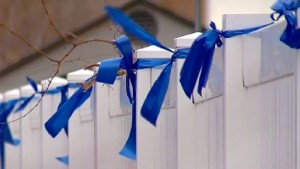 blue ribbon rolls used in a community prayer ribbon campaign