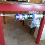 ribbon storage using a tension rod