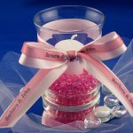 organza ribbons tied around a candle holder