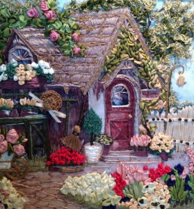 embroidery using satin ribbons to make houses and gardens and other art pieces