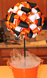 fall and halloween ribbons used to make a ribbon topiary