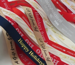 use custom ribbon rolls personalized with names, dates or festive messages for your holiday party