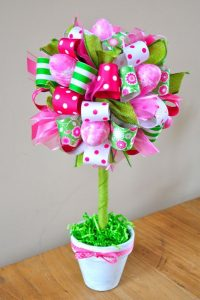 holiday easter ribbons in pinks, greens and whites to make a festive topiary with ribbon and flowers