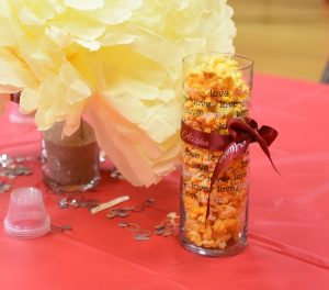 use custom ribbon rolls for your wedding as table decorations and centerpieces