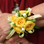 satin face ribbon used for a corsage at a wedding