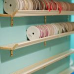 store your ribbon collection using decorative molding shelves