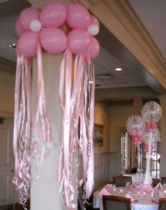 use ribbon rolls and balloons to create unique decorations for your next event
