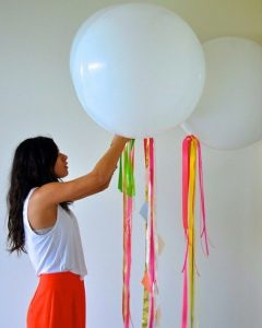 use fun bright ribbon rolls to accent balloons you are decorating with