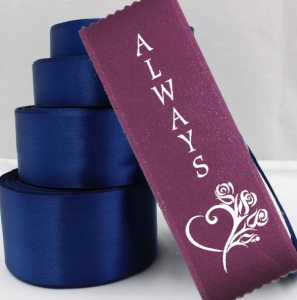 nave blue ribbon rolls and burgandy badge ribbons for a fall wedding