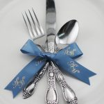 some ribbons will improve your event better than others, like this satin ribbon roll wrapped around silverware
