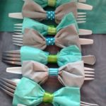 strips of ribbon roll wrapped around cutlery create a bow tie to celebrate your dad