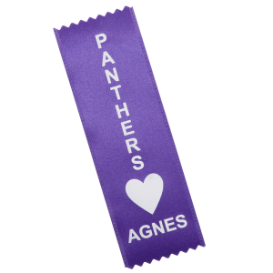 A purple ribbon with a vertical orientation, imprinted with gold text and a heart graphic used for special olympics.