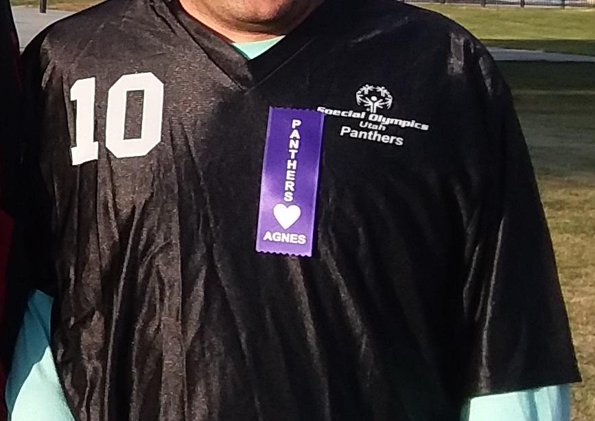Darrell Tondro wearing a purple custom badge ribbon.