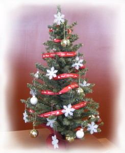 use custom ribbon rolls for your holiday decorating by wrapping them around a Christmas tree