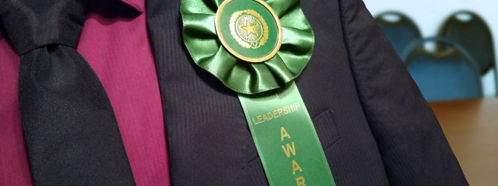 giving custom rosette ribbons as employee awards helps with company unity