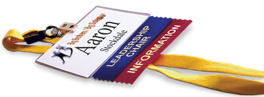 Two badge ribbons attached to a name badge to improve the wearer's networking strategy.