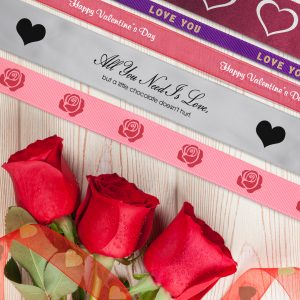 Add icons and graphics to ribbon rolls for Valentine's Day ribbons for any business.