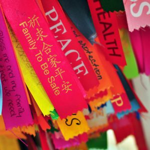 Prayer ribbons with messages of caring and understanding.
